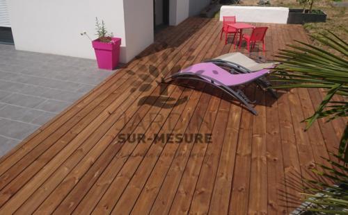 Terrasse teintée marron par imprégnation